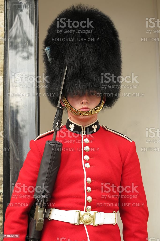 Young royal guard protecting Crown Jewels at Tower of London stock photo