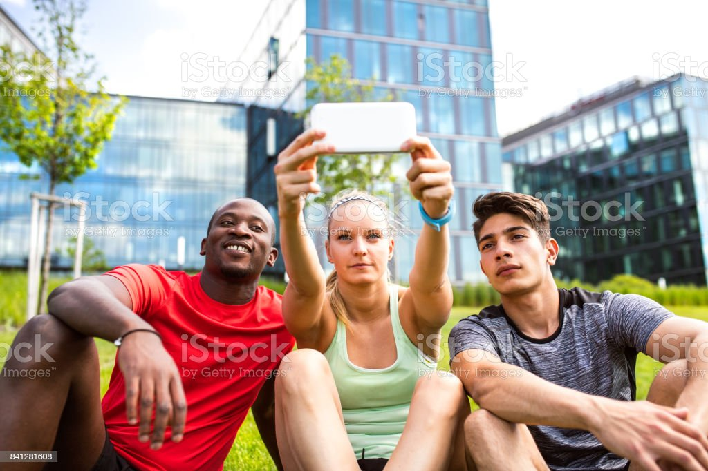 Young runners in the city taking selfie witn smart phone. stock photo
