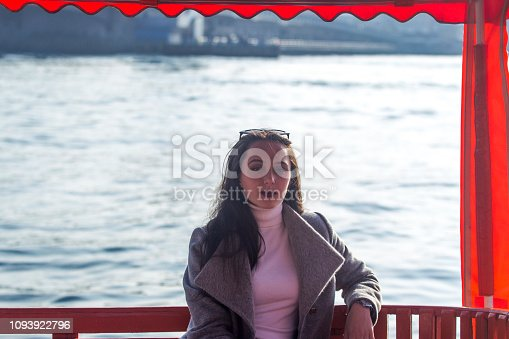 Young russian woman posing at tour boat near golden horn  karakoy istanbul  turkey