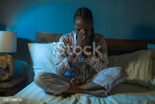 617364644 istock photo young sad and depressed black afro American woman on bed at home unhappy and sleepless at night feeling overwhelmed suffering depression problem and insomnia 1237706214