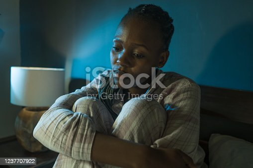 617364644 istock photo young sad and depressed black afro American woman on bed at home unhappy and sleepless at night feeling overwhelmed suffering depression problem and insomnia 1237707922