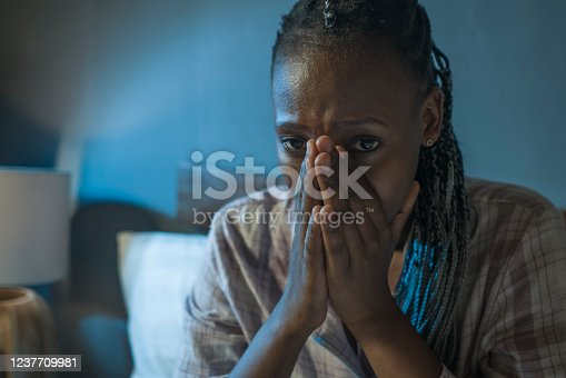 617364644 istock photo young sad and depressed black afro American woman on bed at home unhappy and sleepless at night feeling overwhelmed suffering depression problem and insomnia 1237709981