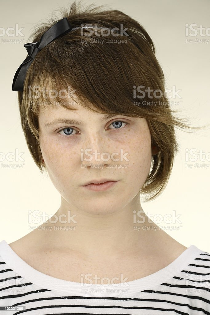 young sad girl looking at the camera with blue eyes royalty-free stock photo