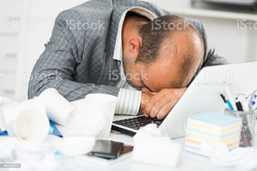 Young sad man tired of working and sleeping royalty-free stock photo