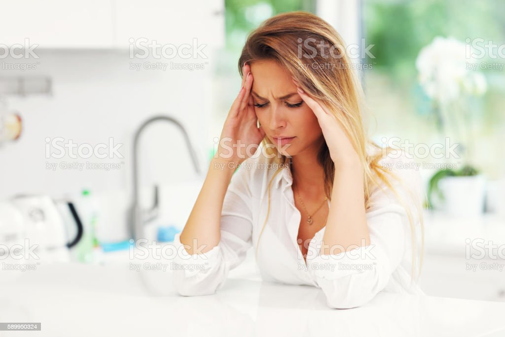 Young sad woman in kitchen - Royalty-free Adult Stock Photo