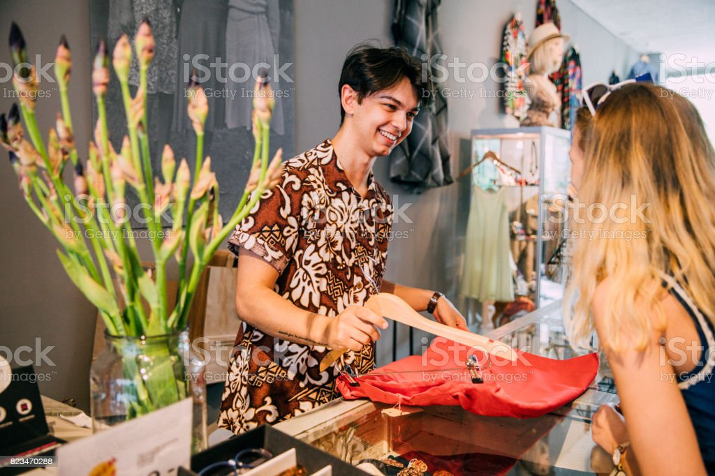 Young Salesman in a Clothing Store stock photo