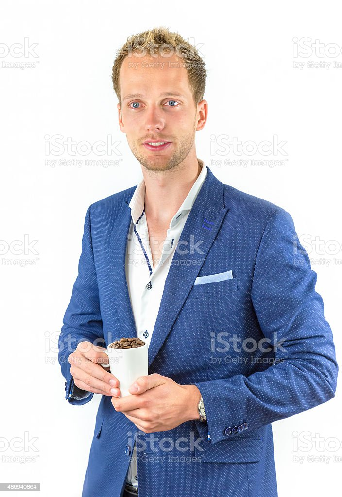 Young salesman promoting coffee beans in cup stock photo