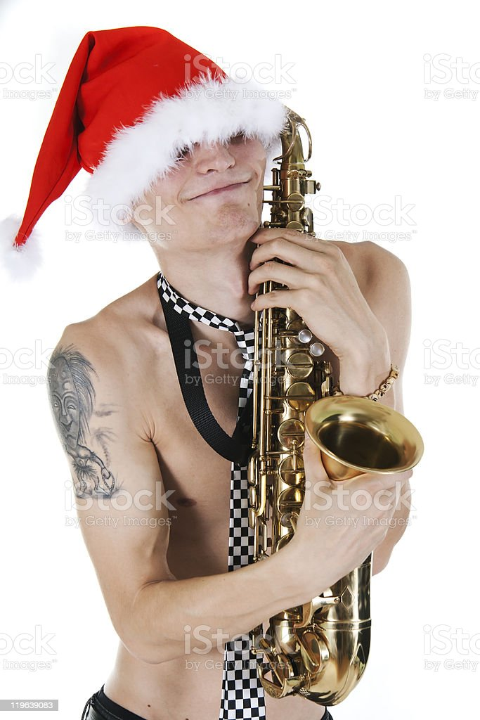 Young Santa embraces a saxophone royalty-free stock photo