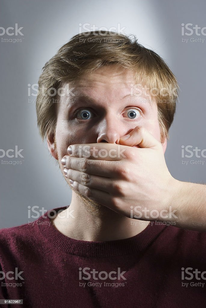 young scared adult with hand covering mouth royalty-free stock photo