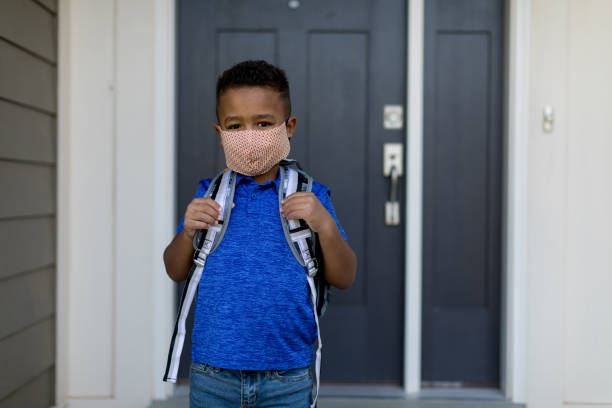 Young School Boy wearing Face Mask