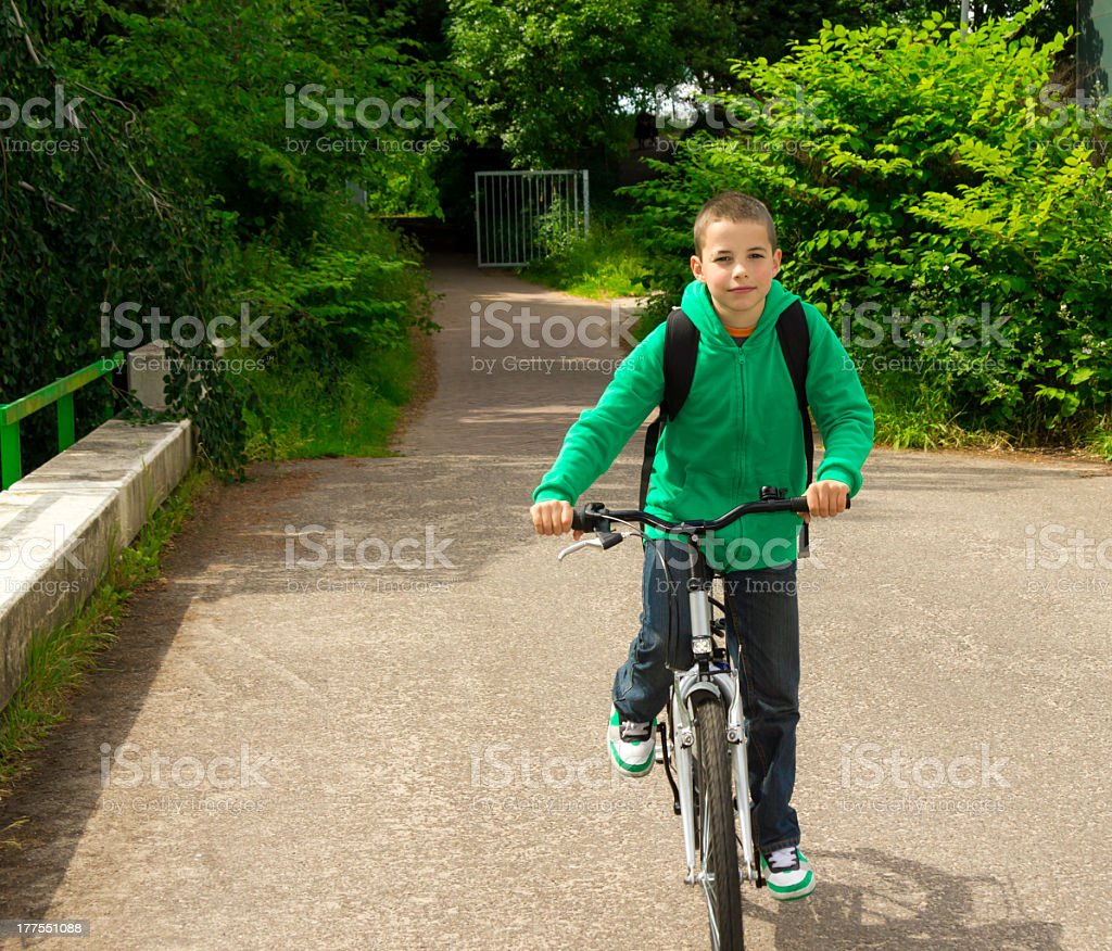 Young school boy with backpack on a bicycle royalty-free stock photo