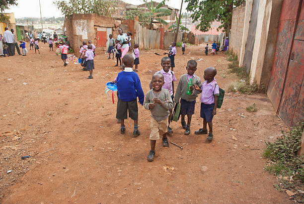 young school boys on a street of kibera, nairobi, kenya. - disinherit stock pictures, royalty-free photos & images