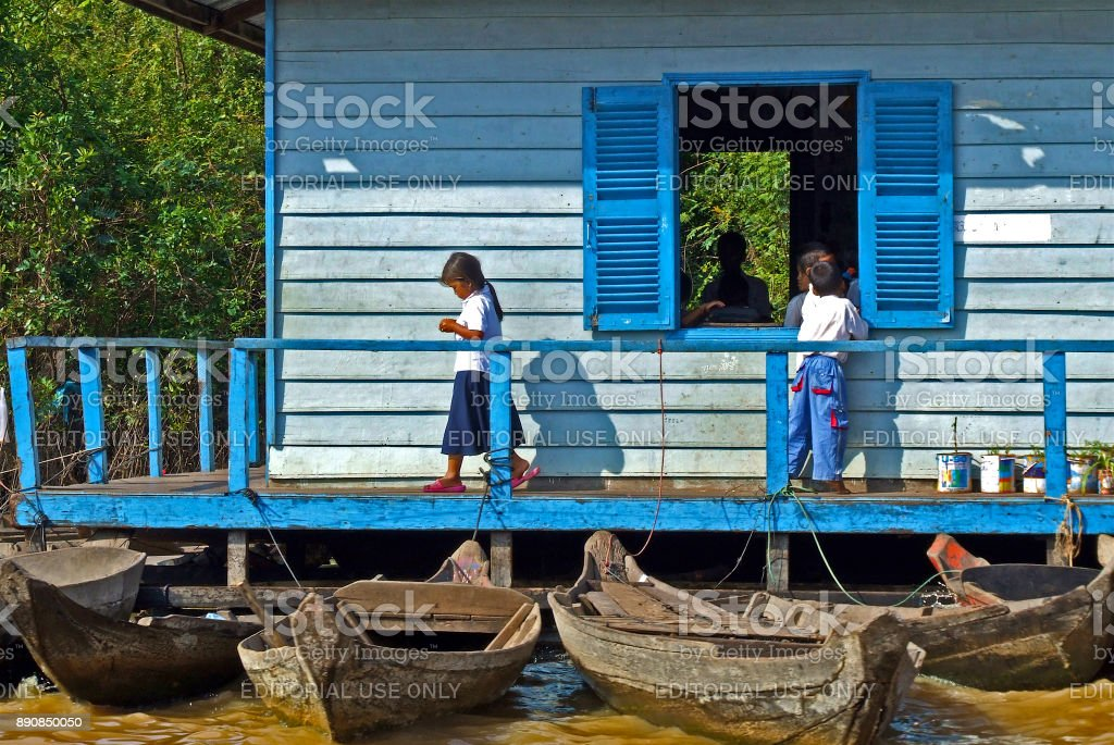 Young school children on floating school stock photo