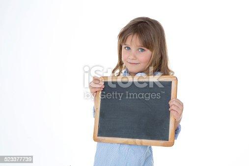istock young school girl in classroom 523377739