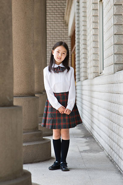 Young schoolgirl posing in school uniform  japanese school girl stock pictures, royalty-free photos & images