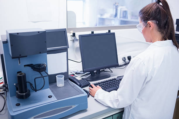 Young scientist typing on his computer stock photo