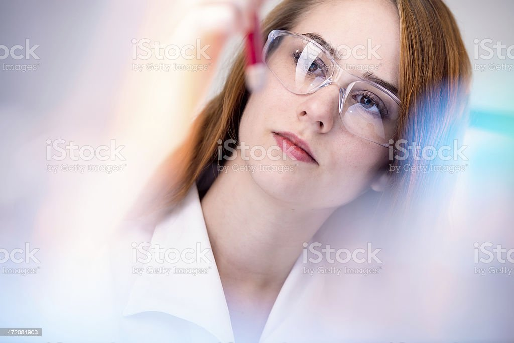 A young scientist wearing large square spectacles stock photo