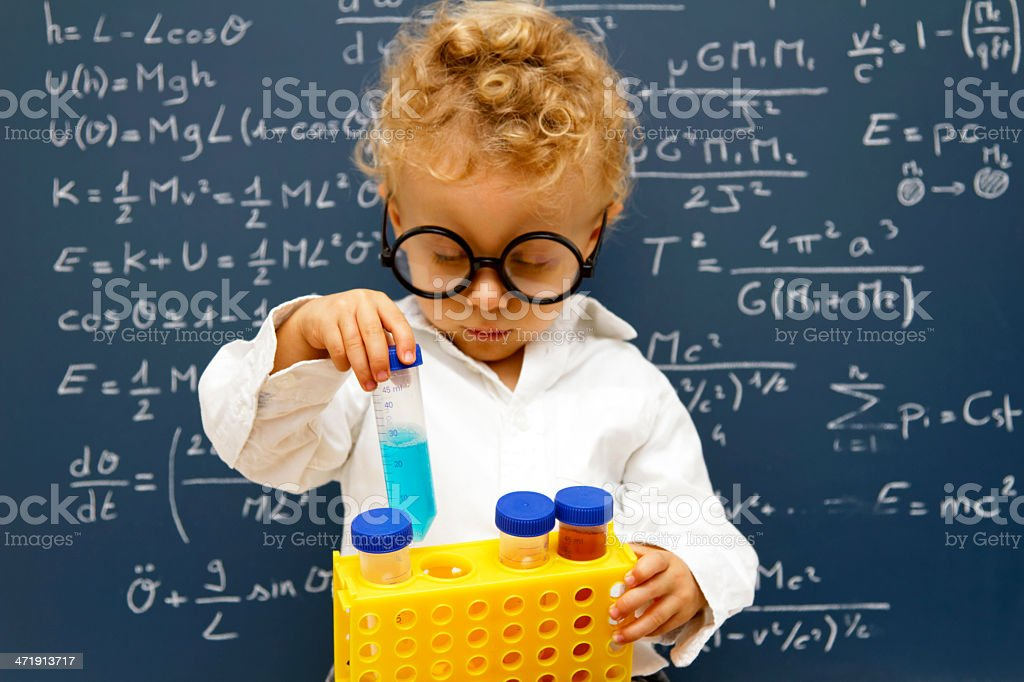Young scientist with toy beakers​​​ foto
