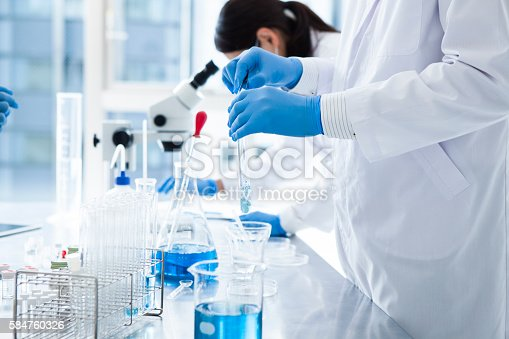 istock Young scientist works in modern biological lab. 584760326