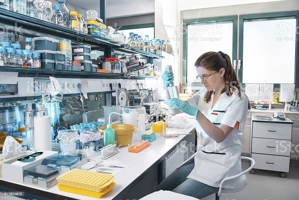 Young scientist works in modern laboratory stock photo