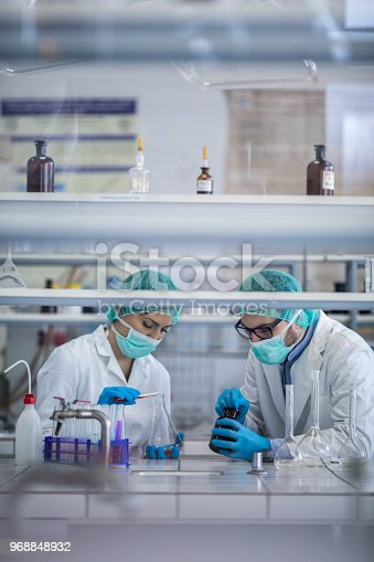 499203366istockphoto Young scientists working with chemical substances during medical research in a laboratory. 968848932