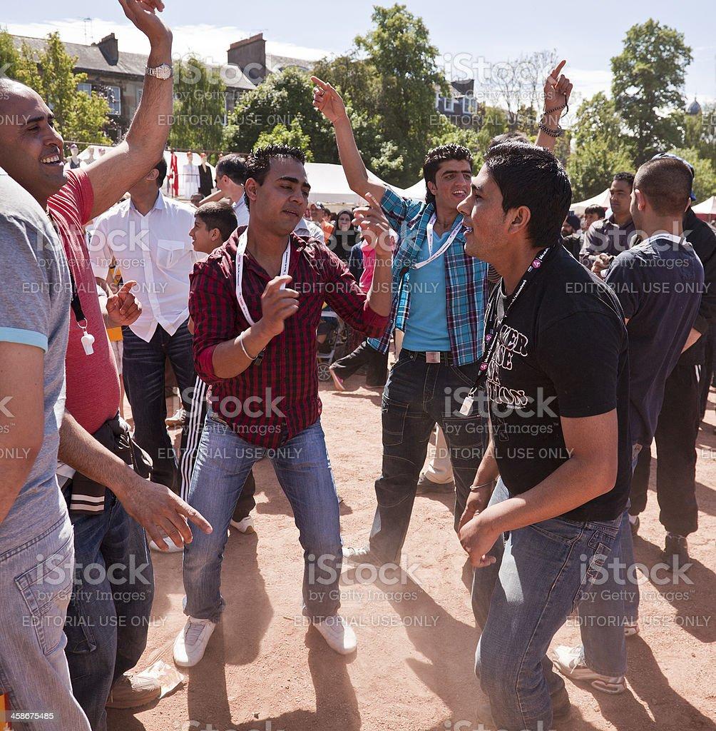 Young Scots-Punjabis dancing Bhangra; Glasgow Mela stock photo