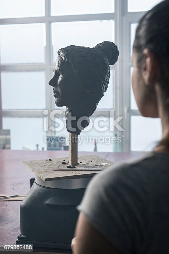 517780131 istock photo Young sculptor creates a clay sculpture 679352488