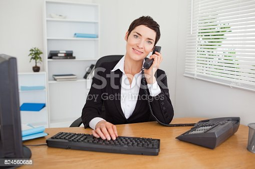 istock Young secretary answering the phone 824560688