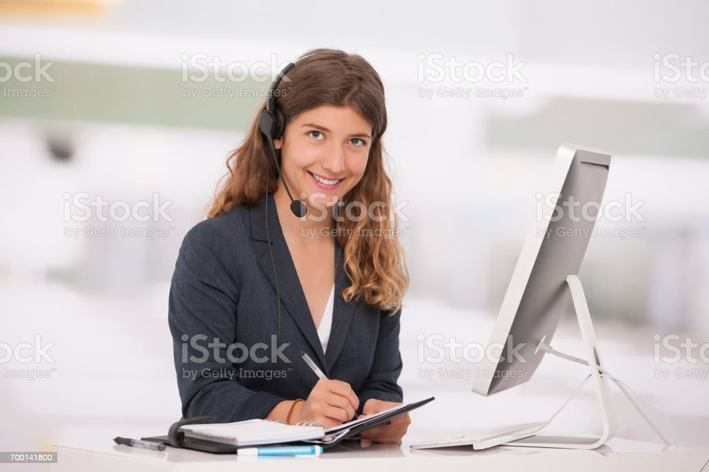 young secretary taking notes stock photo