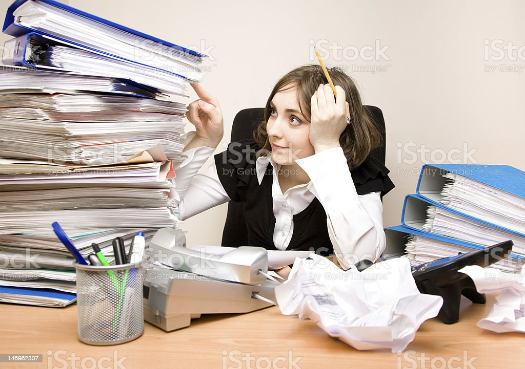 Young secretary with a lot of folders royalty-free stock photo