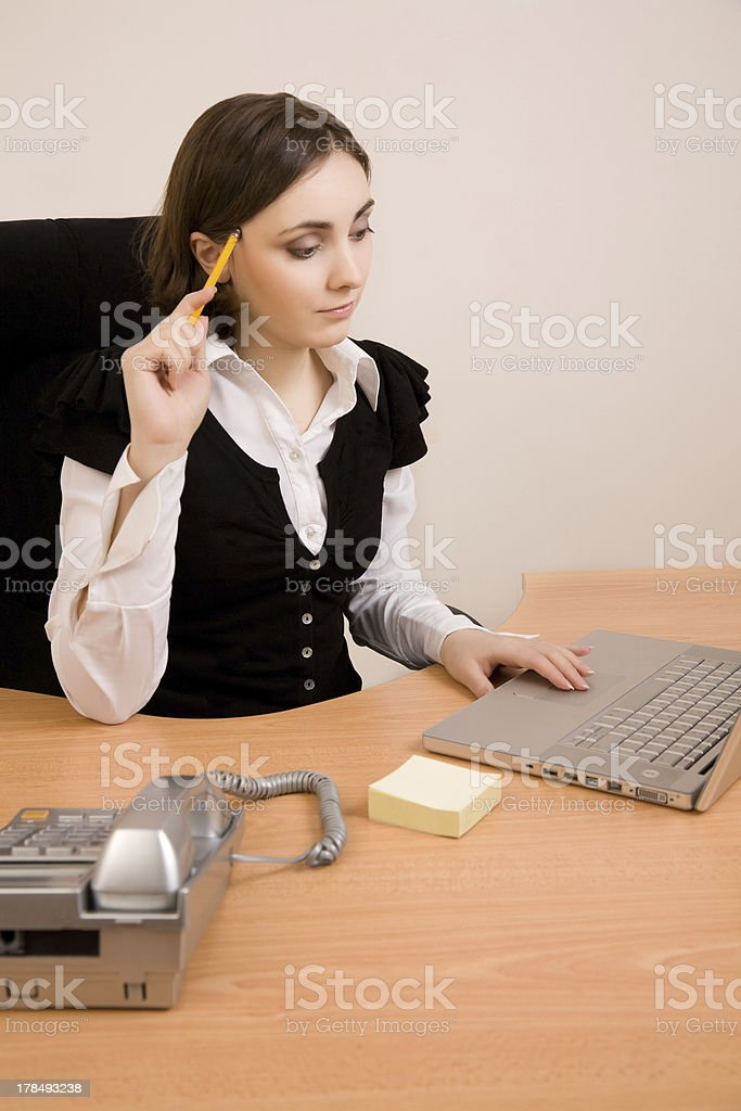 Young secretary with  telephone and pencil royalty-free stock photo