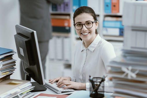 istock Young secretary working and smiling 916423226