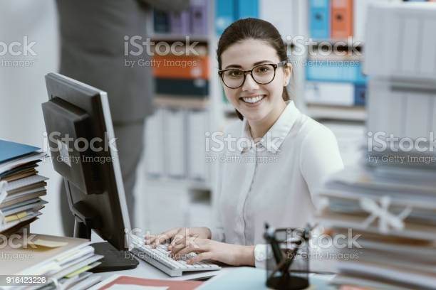 Young secretary working and smiling picture id916423226?b=1&k=6&m=916423226&s=612x612&h= 7gifyuadowqet12lvep4nnp4hlt8ln gzof4lllxei=