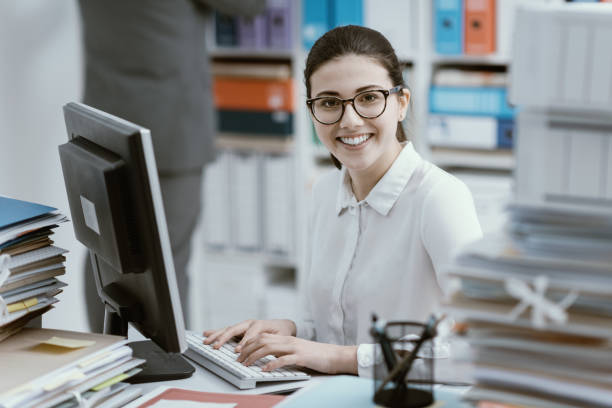 Young secretary working and smiling stock photo