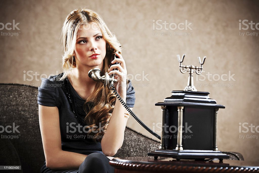 Young sensuality girl using an antique telephone. royalty-free stock photo