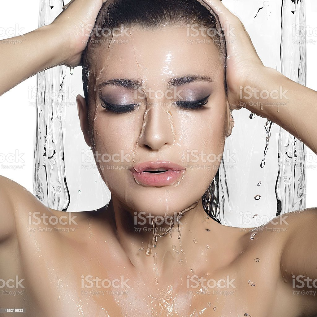 Young Sensuality Woman Showering. Spa Treatment. Wet Make-up stock photo
