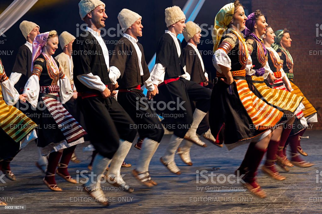 Young Serbian dancers in traditional costume stock photo