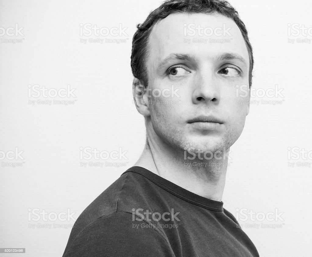 Young serious Caucasian man, closeup portrait stock photo