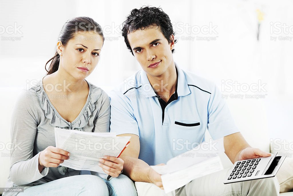 Young serious couple doing their taxes royalty-free stock photo
