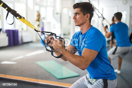 istock Young serious man exercising on Pilates class in health club. 497394144