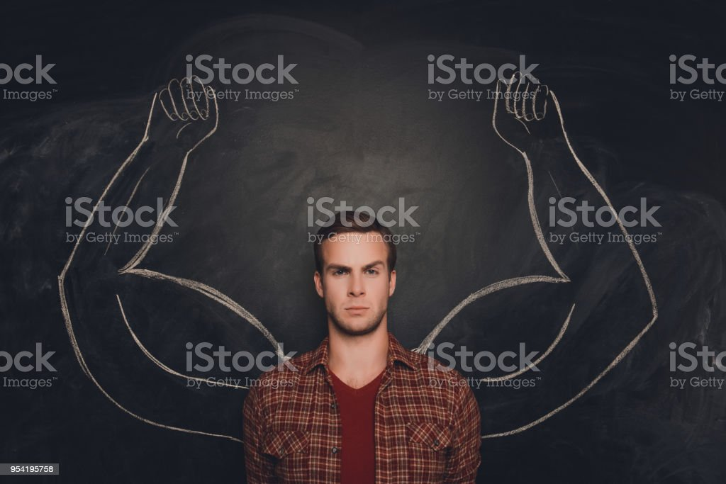Young serious man  with drawn strong and muscled arms stock photo