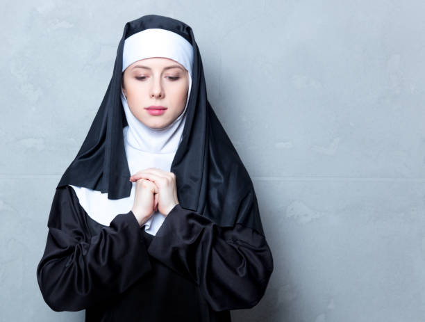 Young serious nun stock photo