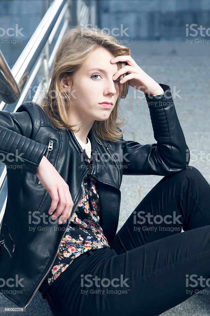 Young serious woman sitting on stairs. royaltyfri bildbanksbilder