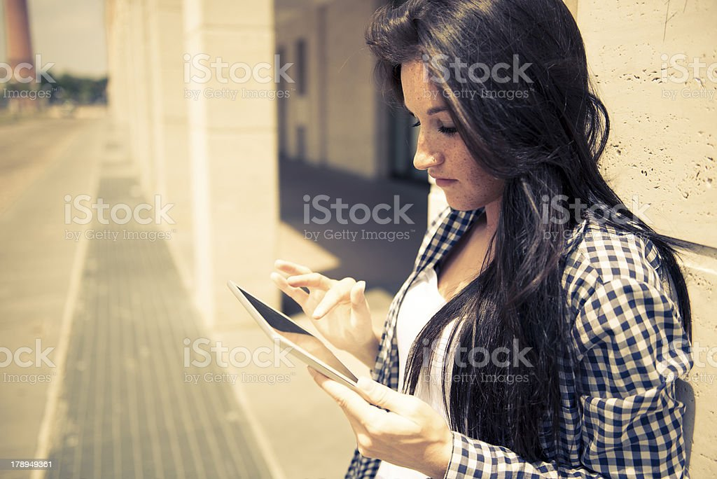 Young serious woman using digital tablet royalty-free stock photo