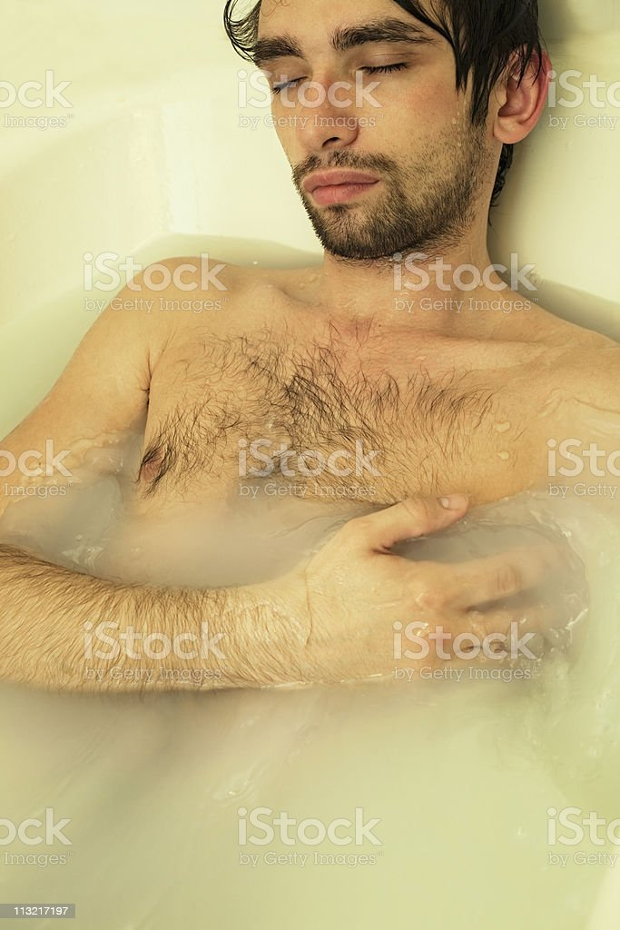 Young Sexual Tanned Naked Guy In Bath Royalty Free Stock Photo