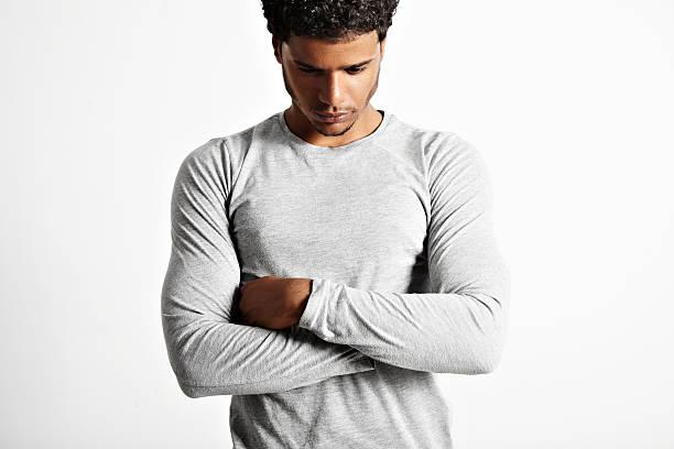 Young sexy black model wearing light gray longsleeve t-shirt stock photo