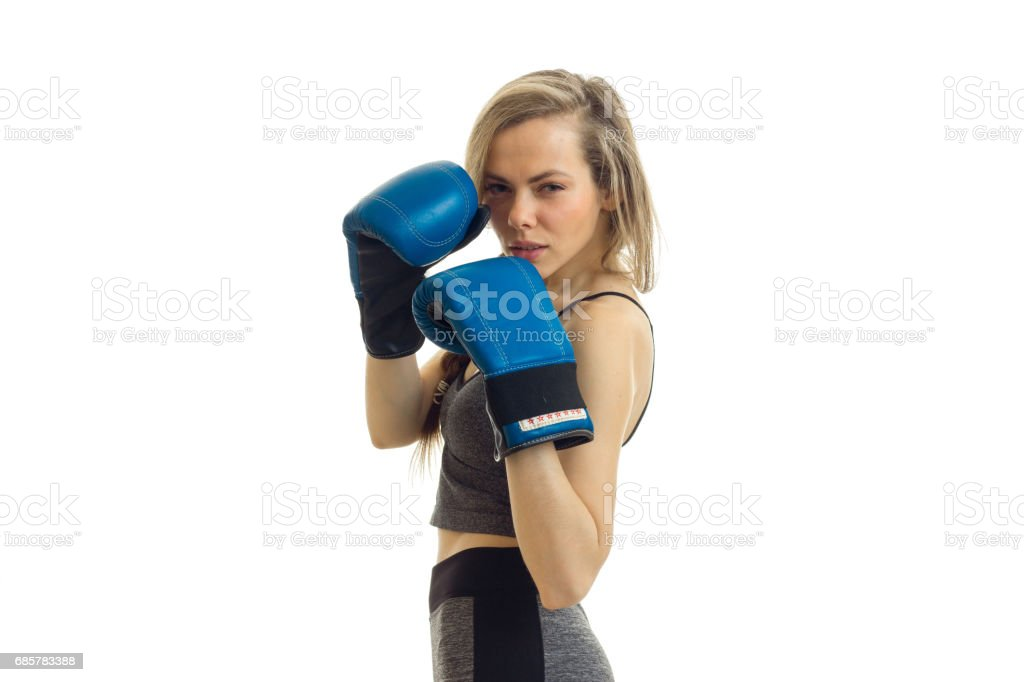 young sexy blonde posing on camera in blue boxing gloves photo libre de droits