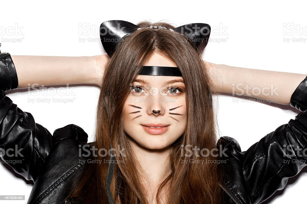 young sexy brunette woman wearing cat ears stock photo
