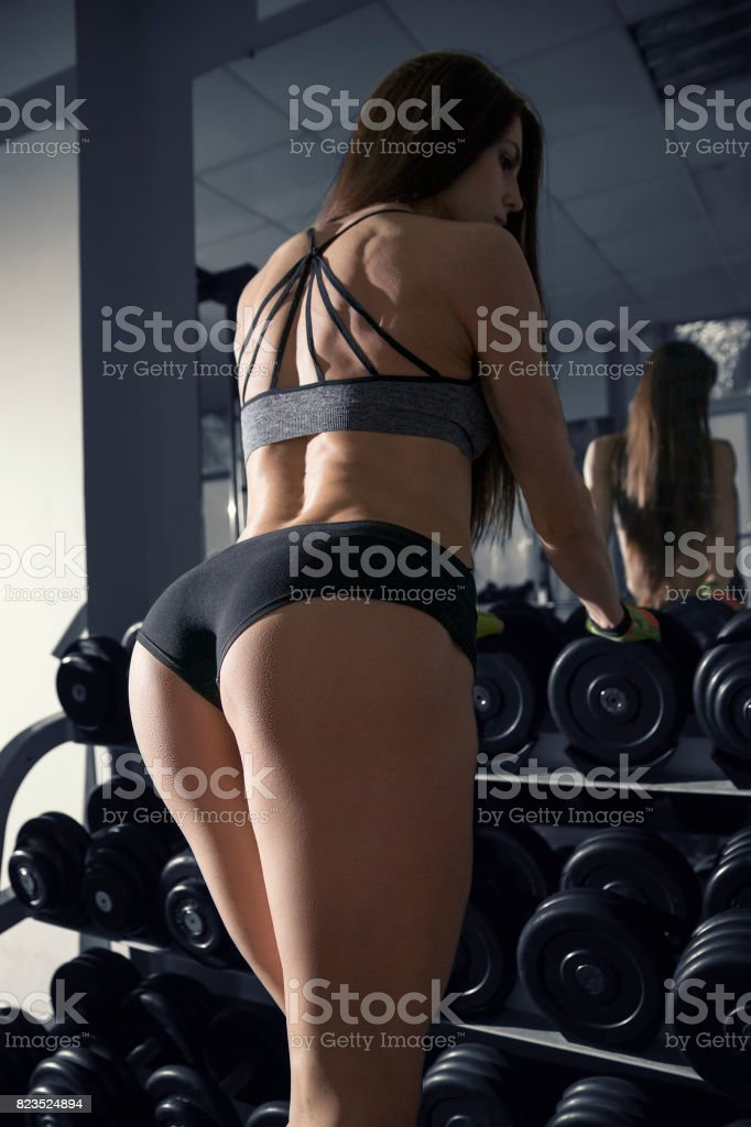 Young Sexy Fitness Woman Workout With Dumbbells In The Gym Royalty Free Stock Photo