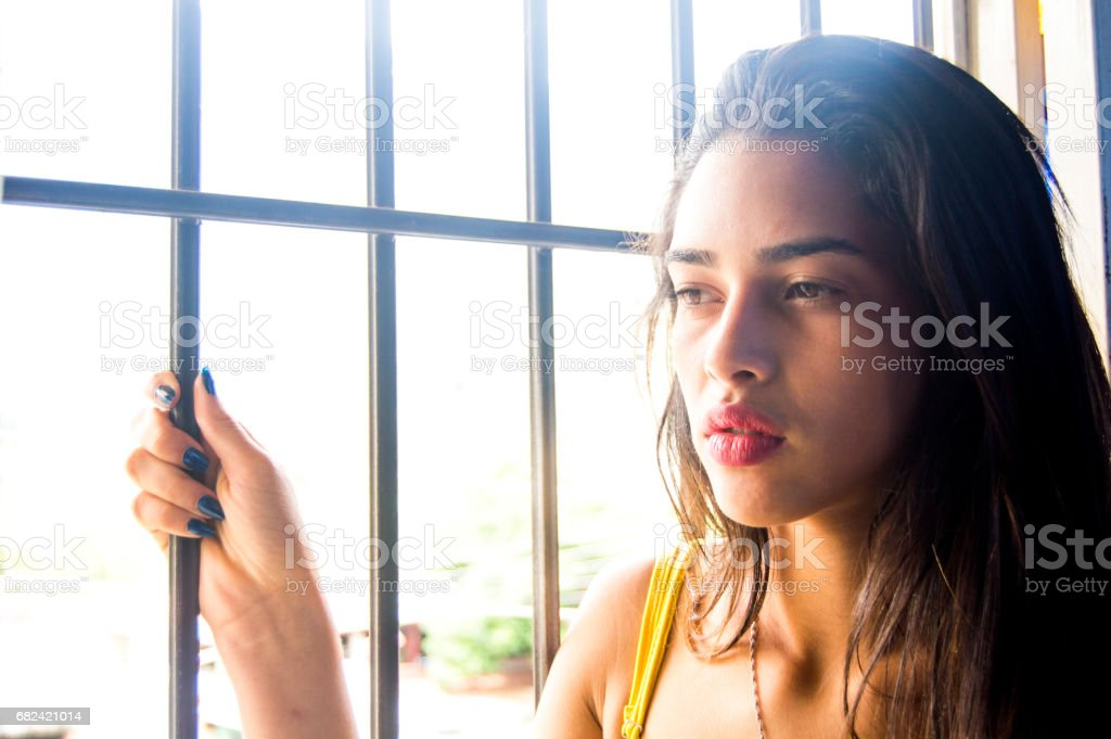 young sexy girl behind the window royalty-free stock photo